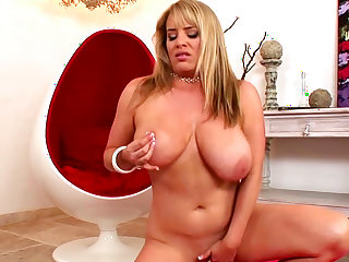 Blonde Maggie Green is licking her nice hot nipples!