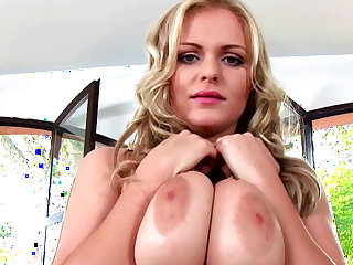 Sweet blonde Charley G is playing with her boobies