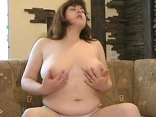 Chubby babe Julya demonstrates her ass on the cam