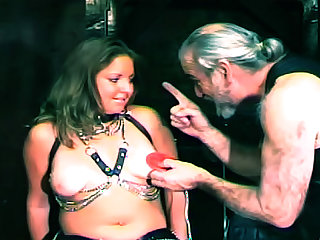 Dildo fucking a curvy girl in bondage