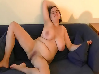 Fat girl masturbates her shaved pussy