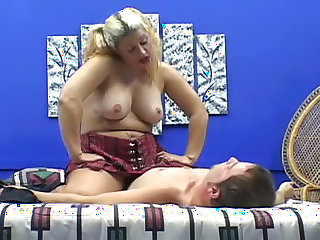 She sits on him in her pantyhose