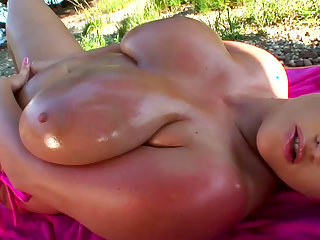 Blonde with huge boobs gives arousing solo